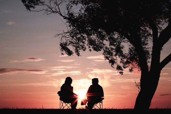 couple talking at sunrise Relationship Quizzes