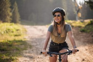 women riding bike, things to do alone