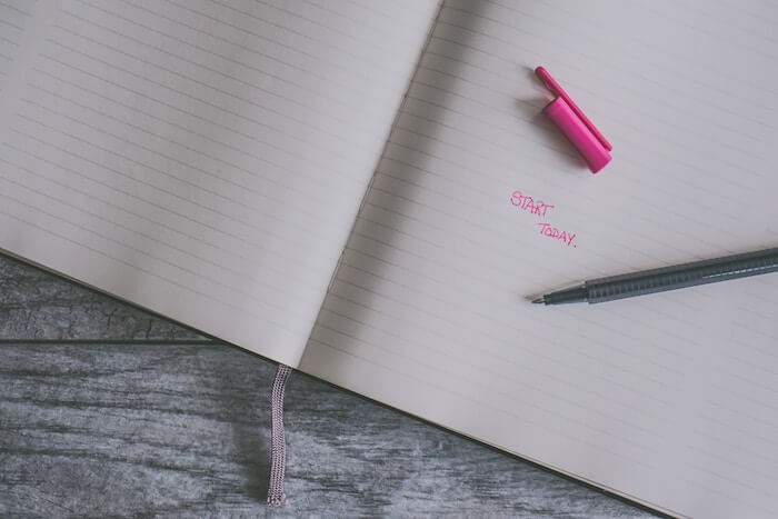 open journal with pen How to Create A Gratitude List