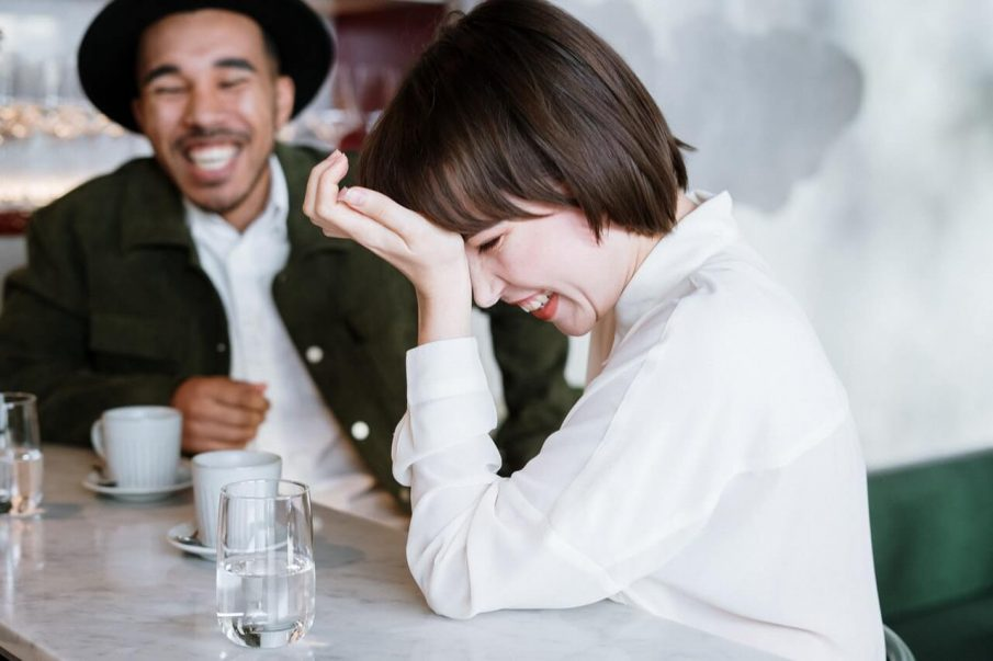 couple laughing, how to end a conversation