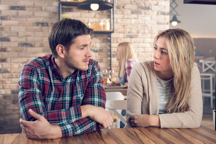 woman and man talking at table how to end a conversation