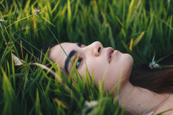 woman in grass, finding meaning in life