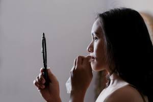 woman looking in mirror self-loathing personality
