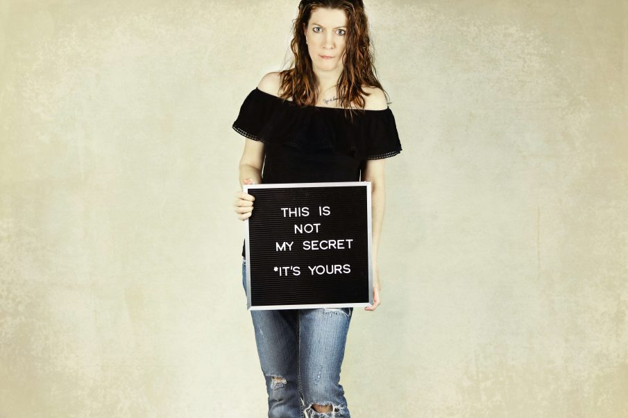 woman with sign, be true to yourself