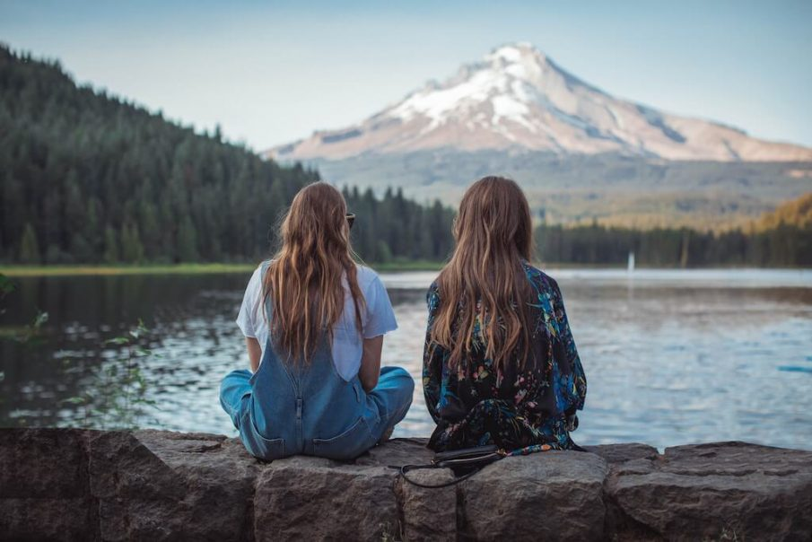 two women looking at mountain, one-sided friendship