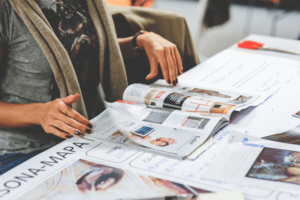 woman with magazine, vision board ideas