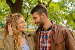 couple talking, signs of attraction