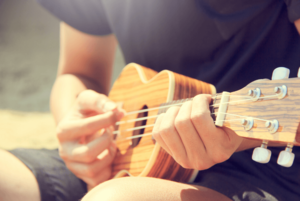man playing guitar, hobbies for introverts