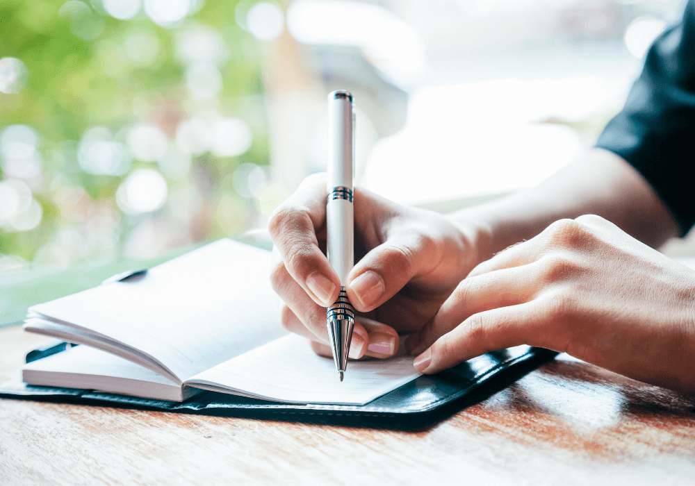 Writing in journal, personal mission statement