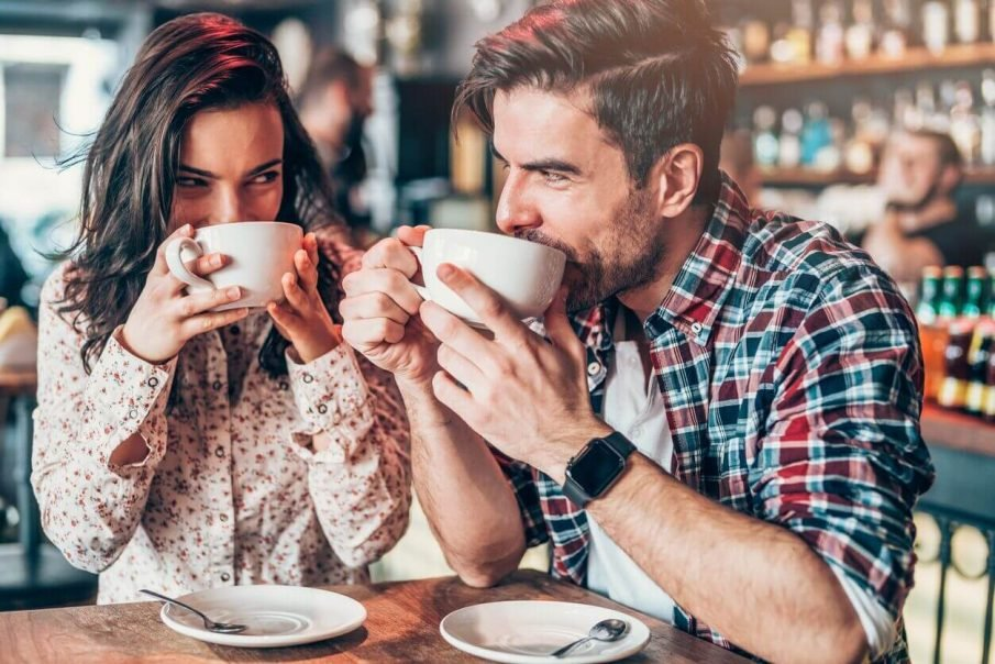 couple drinking coffee, flirty questions to ask a guy