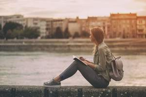 woman writing, mantras to live by