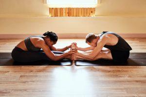 couple doing yoga, love compatibility test