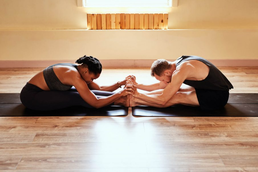 couple doing yoga, love compatibility test
