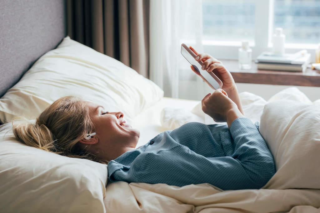 woman texting in bed sweet texts for him