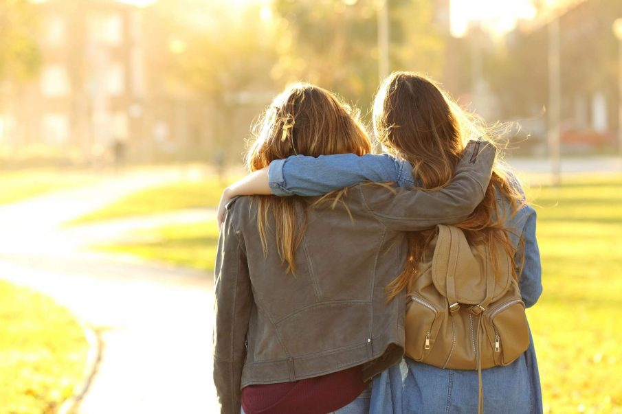 friends hugging, you teach people how to treat you