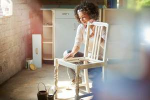 woman refinishing chair, are interests and hobbies the same thing