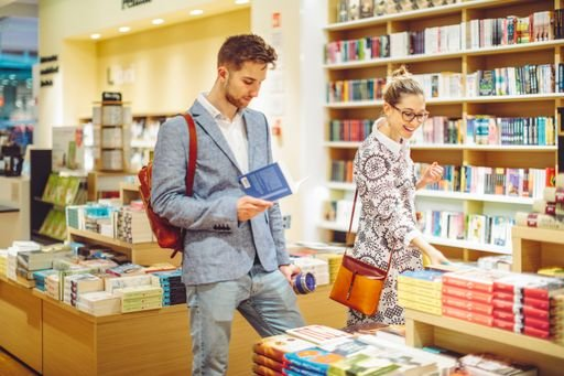 man and woman in the bookstore - signs a married woman likes you