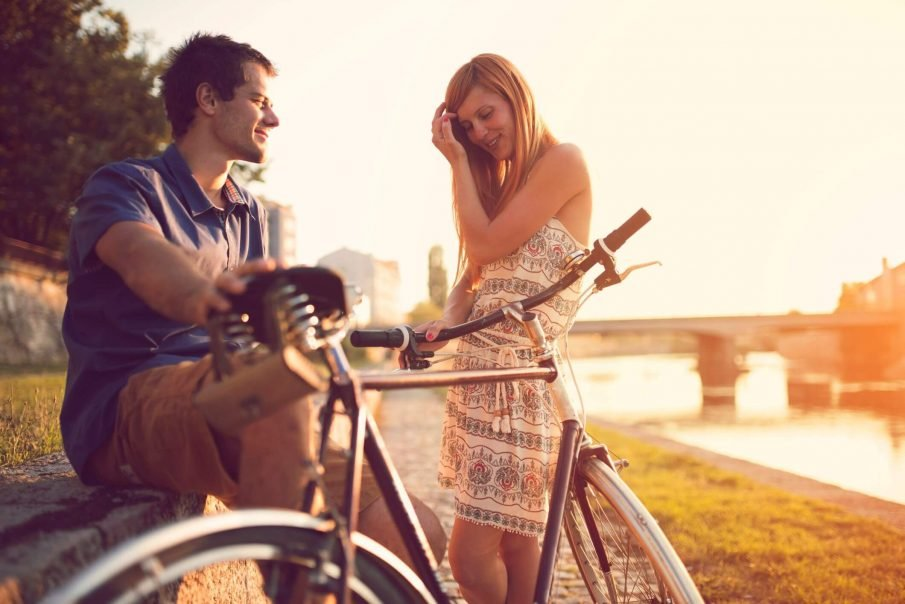 couple on bikes, signs a girl likes you but is trying not to show it