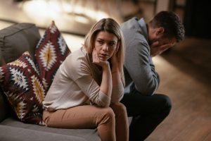 unhappy couple, signs of cheating husband guilt