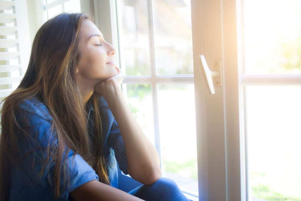 woman at window, living in the moment quotes